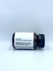 bottle of microdose mushroom and CBD capsules